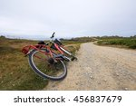 red bicycle by the dusty road... | Shutterstock . vector #456837679