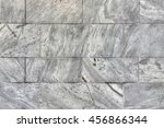 Small photo of Ageless marble stone wall background with copy space