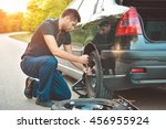 auto mechanic changing  tire on ...   Shutterstock . vector #456955924