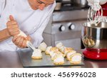 pastry chef decorating with a... | Shutterstock . vector #456996028