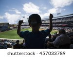 child standing and cheering at... | Shutterstock . vector #457033789