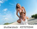 joyful smiling couple resting... | Shutterstock . vector #457070344