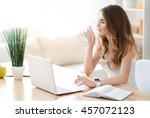 pleasant young woman sitting at ... | Shutterstock . vector #457072123