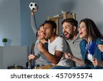 Group Of Friends Watching Spor...