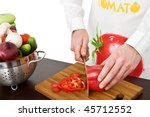 male chef cutting vegetables | Shutterstock . vector #45712552
