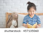 happy asian girl reading story... | Shutterstock . vector #457135060