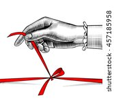 woman's hand untying bow of red ... | Shutterstock .eps vector #457185958