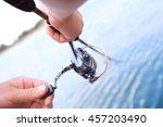 closeup of fisherman s hand... | Shutterstock . vector #457203490
