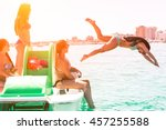 girls having fun diving from... | Shutterstock . vector #457255588
