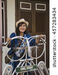 Small photo of PENANG, MALAYSIA - APRIL 27 : Thai woman travel and portrait at George Town on Aceh Street at George Town on April 27, 2016 in Penang, Malaysia.