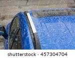 Hail Falls On A Blue Car Roof.
