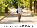 girl riding bicycle on street | Shutterstock . vector #457306414