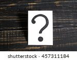 question mark on the paper on a ...   Shutterstock . vector #457311184