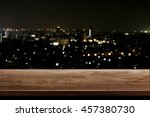 wood table top on night city... | Shutterstock . vector #457380730