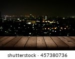 wood table top on night city... | Shutterstock . vector #457380736