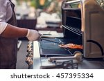 grill chef cooking shrimp grill. | Shutterstock . vector #457395334