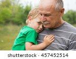 sad little child  boy  hugging...   Shutterstock . vector #457452514