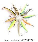 Plastic fishing lures forming a circle, high angle view - stock photo