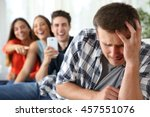 friends bullying to a sad boy...   Shutterstock . vector #457551076