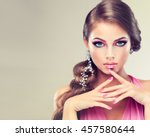 Beautiful model girl with elegant hairstyle . Woman with fashion wedding hair  . Cosmetics, beauty and manicure on nails