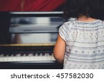 little asian girl play piano at ... | Shutterstock . vector #457582030