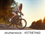 girl on a bicycle at sunset   Shutterstock . vector #457587460
