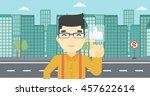 an asian young man pressing...   Shutterstock .eps vector #457622614