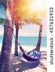 empty hammock between palms... | Shutterstock . vector #457631923