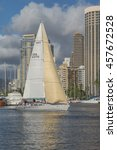 Small photo of Honolulu, Hawaii, USA, July 25, 2016: 2016 Pacific Cup Race contender and crew practice in the Ala Wai Harbor with hotels in the background.