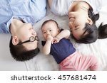 asian baby with parents  lying... | Shutterstock . vector #457681474