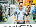 handsome man shopping in... | Shutterstock . vector #457696354