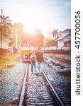 happy young couple on railway... | Shutterstock . vector #457700056