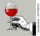 hand holding a glass with red... | Shutterstock . vector #457700074