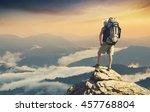 tourist on the peak of high... | Shutterstock . vector #457768804