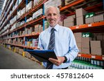 worker holding clibpoard in a... | Shutterstock . vector #457812604