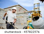 portrait of handsome construction worker on a building industry construction site - stock photo