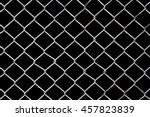 Rusty Chain Link Fence On Blac...