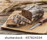Sliced Black Bread On The Old...