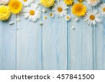 Stock photo garden flowers over blue wooden table background backdrop with copy space 457841500