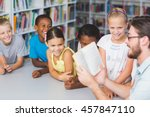 teacher and kids reading book... | Shutterstock . vector #457847110