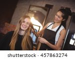 female hairdresser... | Shutterstock . vector #457863274