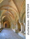 Small photo of July 16, 2015: Gothic arches and columns inside the cloister of Fontfroide Abbey, Languedoc-Roussillon, France