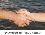 suntanned male hands make