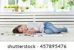 girl sleeping during art class | Shutterstock . vector #457895476