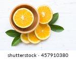 orange slices in bowl on white... | Shutterstock . vector #457910380
