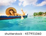 woman paddling in a boat in a... | Shutterstock . vector #457951060