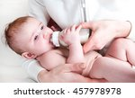 the baby in diapers eating milk ... | Shutterstock . vector #457978978