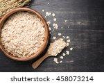 oatmeal or oat flakes on dark... | Shutterstock . vector #458073214