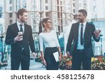 business people. three cheerful ... | Shutterstock . vector #458125678