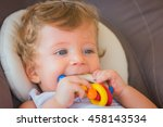 baby boy playing with colorful... | Shutterstock . vector #458143534
